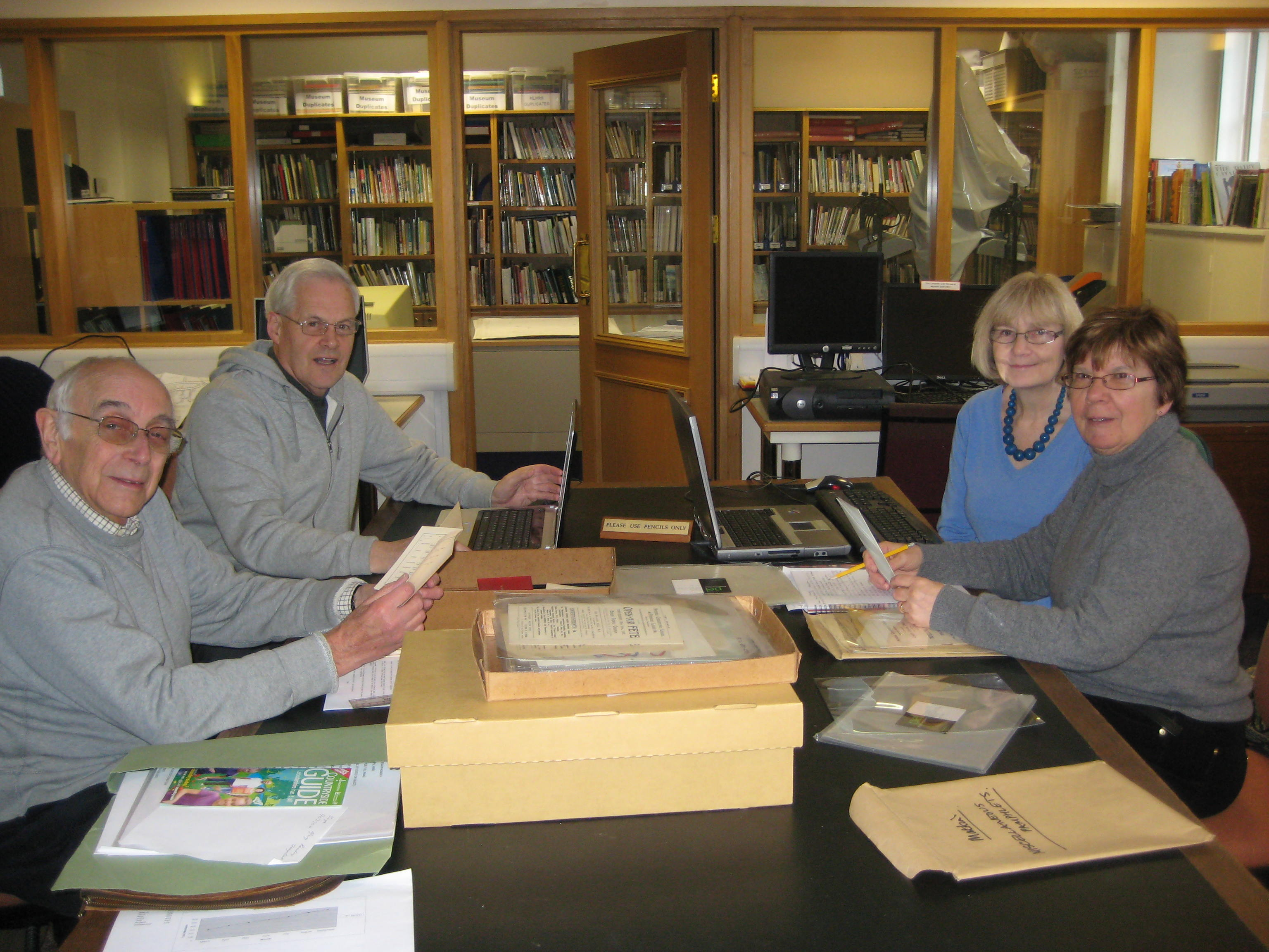 NADFAS Museum afternoon Volunteer Group working on the ephemera collection