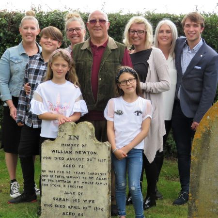 Photo of William & Sarah Newton headstone with visiting family members